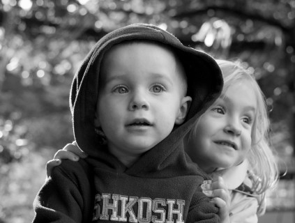 little kids - brother and sister black and white