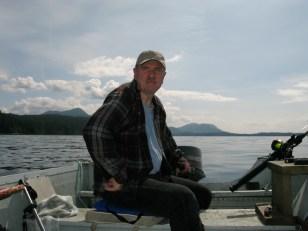 dad driving skiff