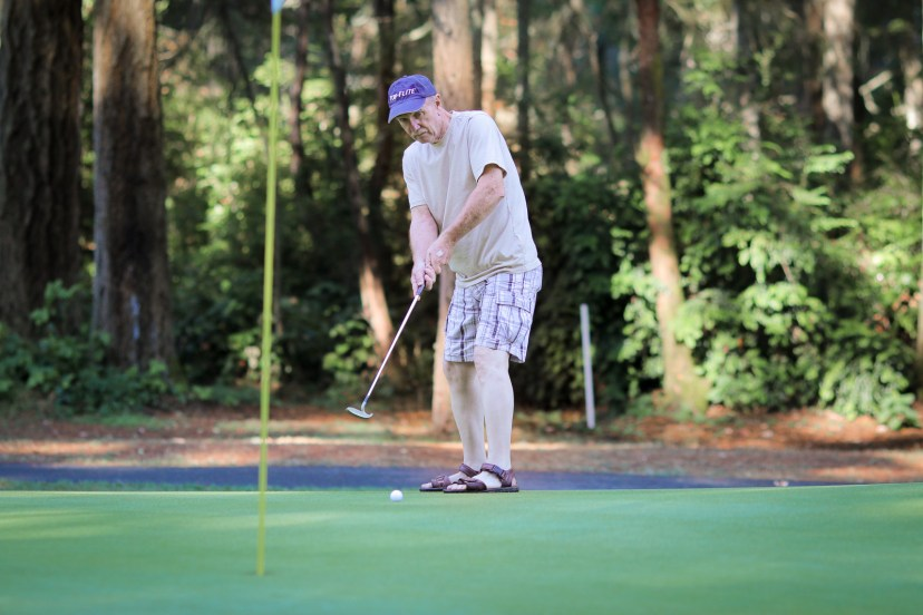 Pop-pop pretending to golf