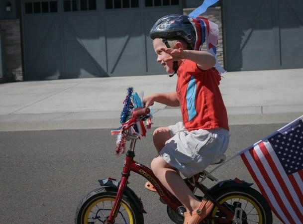 Evan riding patriotic bike