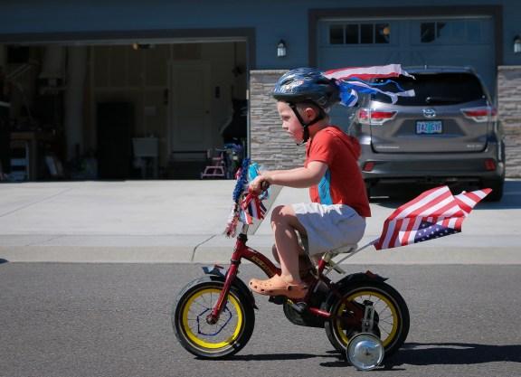 little boy riding patriotic bike
