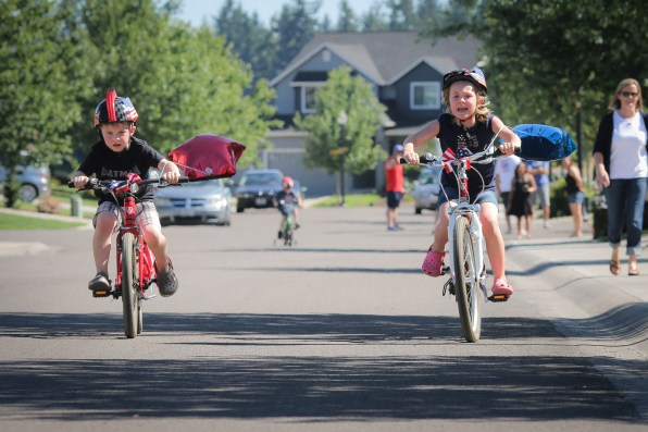 brother and sister racing on bikes