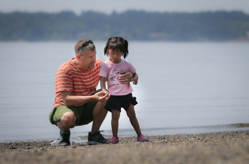 dad with adopted daughter by Puget Sound