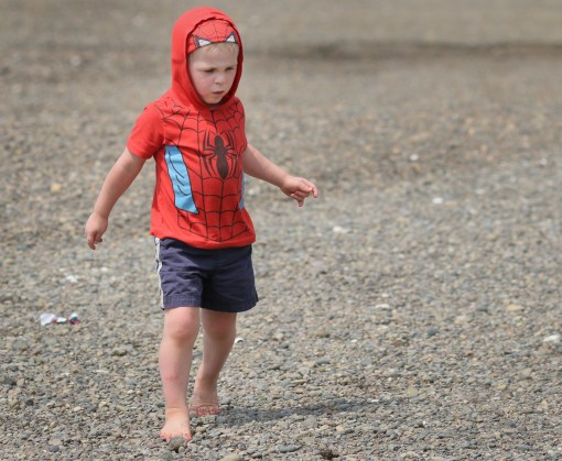 little boy walking on beach