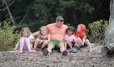 little friends sitting on log