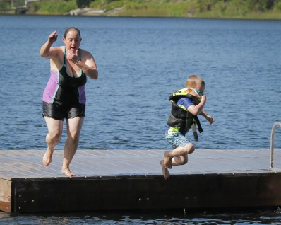 mom and son airborne off dock
