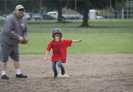 girl running bases