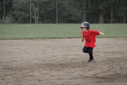 little boy running bases