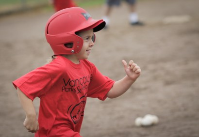 little girl running bases