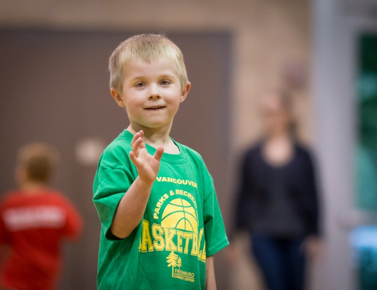 evan waving on basketball court