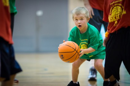 boy playing basketball