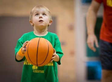 boy concentrating basketball