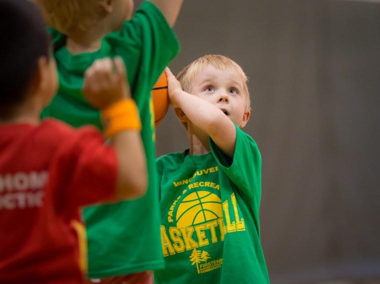 boy shooting basketball