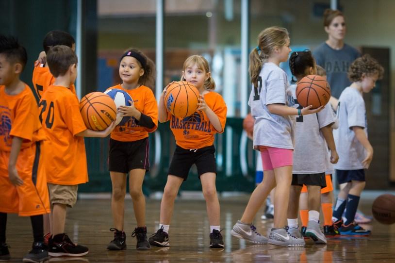 girl playing basketball