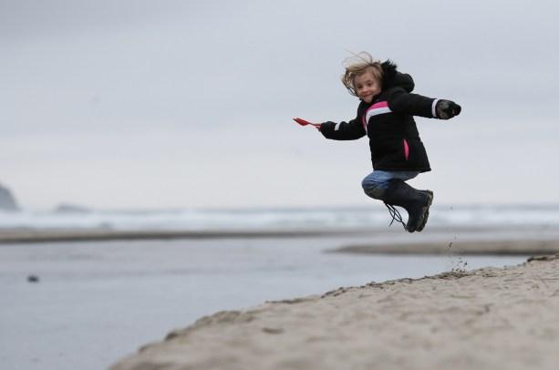 girl in air at beach