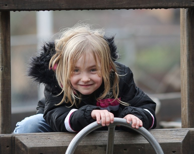 girl in play structure