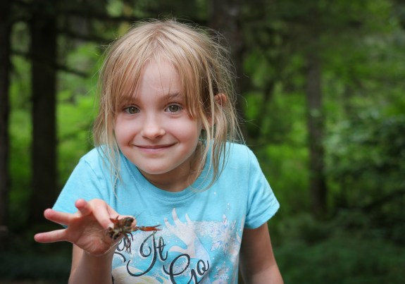 girl holding crab