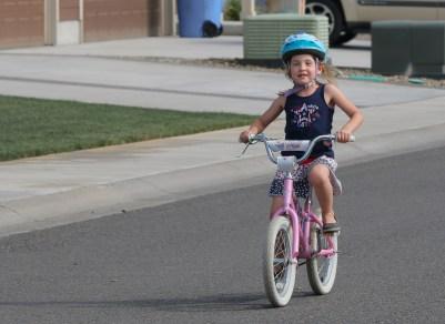 little girl riding bike