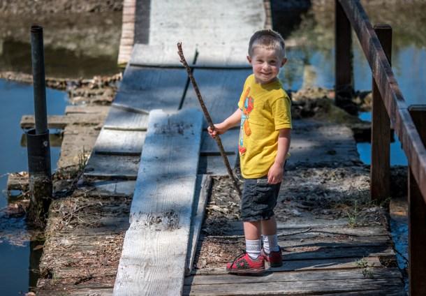 little boy with a stick