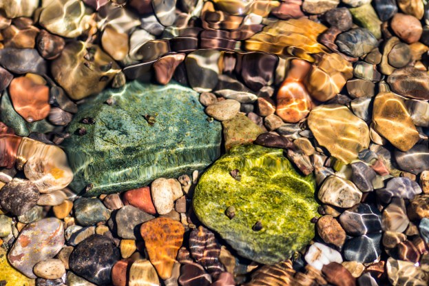 colorful rocks in a creek