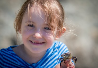 little girl holding crab