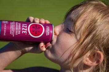 little girl drinking izze