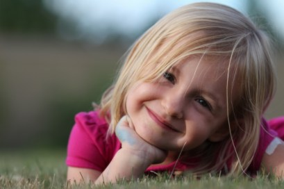 cute little girl posing in grass