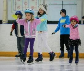little girl ice skating lessons