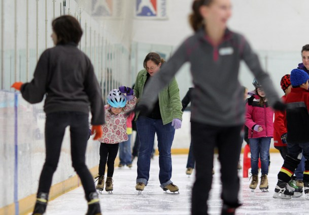 mom and daughter ice skate