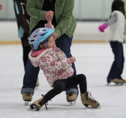 little girl falling ice skating