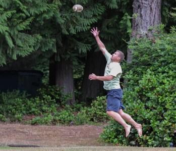 man jumping for football reception