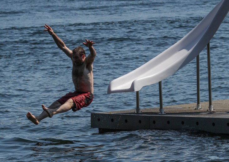 man flying off water slide