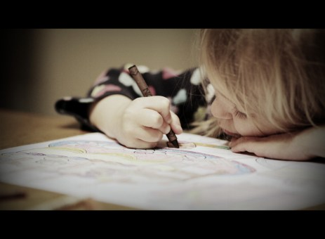 little girl with crayon