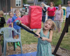 alaina whacking pinata with baseball bat