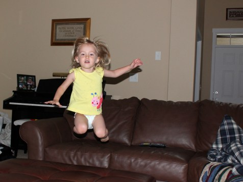 little girl airborne off couch