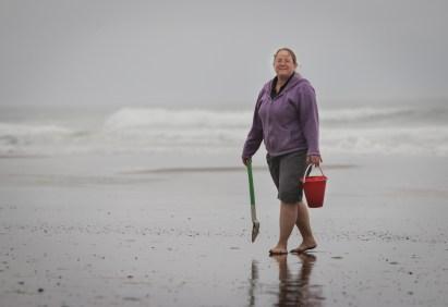 mom walking on beach