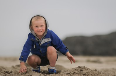 little boy kneeling