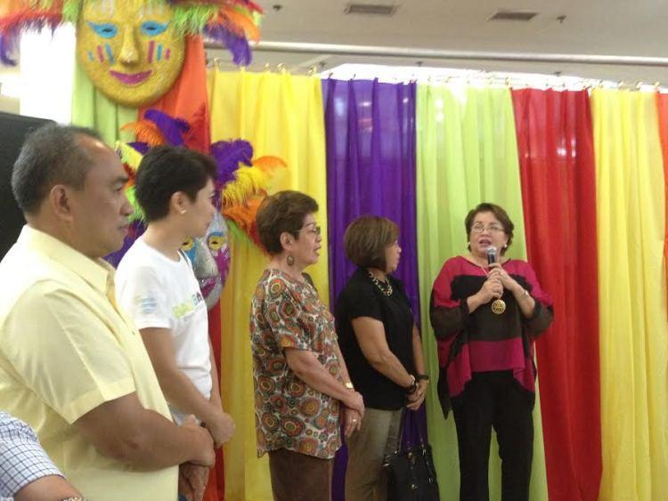 Balik Cebu committee chair Tetta Baad explains the Balik Balay campaign during the Balik Cebu booth opening at Ayala Center Cebu on Monday.