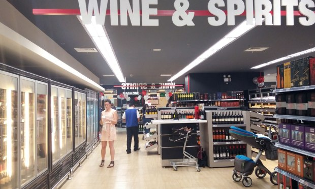 The wine and spirits section has a consultant (shown in photo) to help you choose.