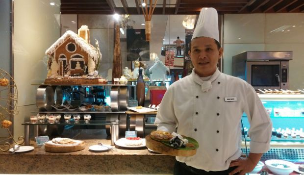 Marco Polo chef shows off the dessert station's new dishes.