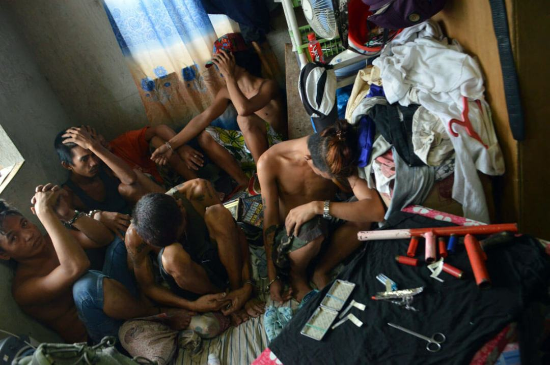 DRUG RAID. Suspects are rounded up in a drug raid in Barrio Luz. The fight against drugs was one of the biggest news stories last year with many policemen getting killed in the campaign. (Photo by Allan Tangcawan)