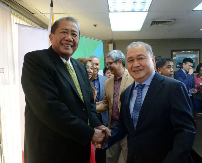 Transportation Secretary Arthur Tugade and PLDT and Smart Chairman, President, and CEO Manuel V. Pangilinan.