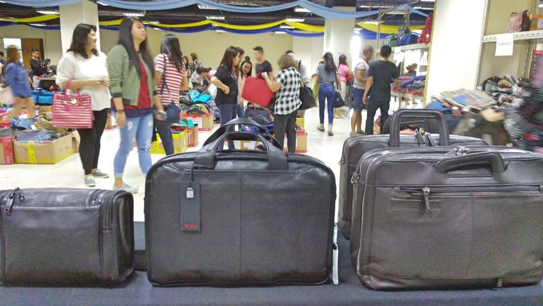 Bags, carry-ons on sale.