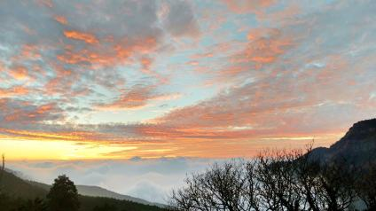 The sun sets on a sea of clouds in Alishan.