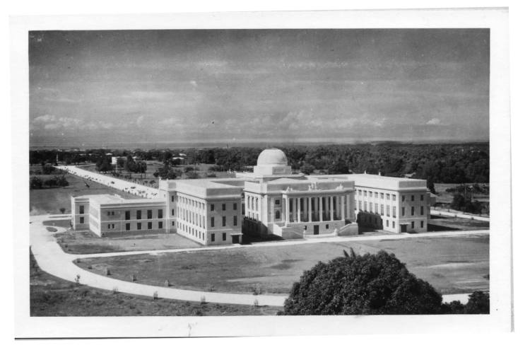 """""""REMOTE LOCATION."""" A photo of the Capitol taken in 1940. When it was being built, people criticized the location of the new Capitol building. Radio commentators made fun of it saying that it was so remote only monkeys from the hills behind it would attend the sessions in the building. (Photo from the Medalle Collection and used with permission of the Cebuano Studies Center of the University of San Carlos.)"""