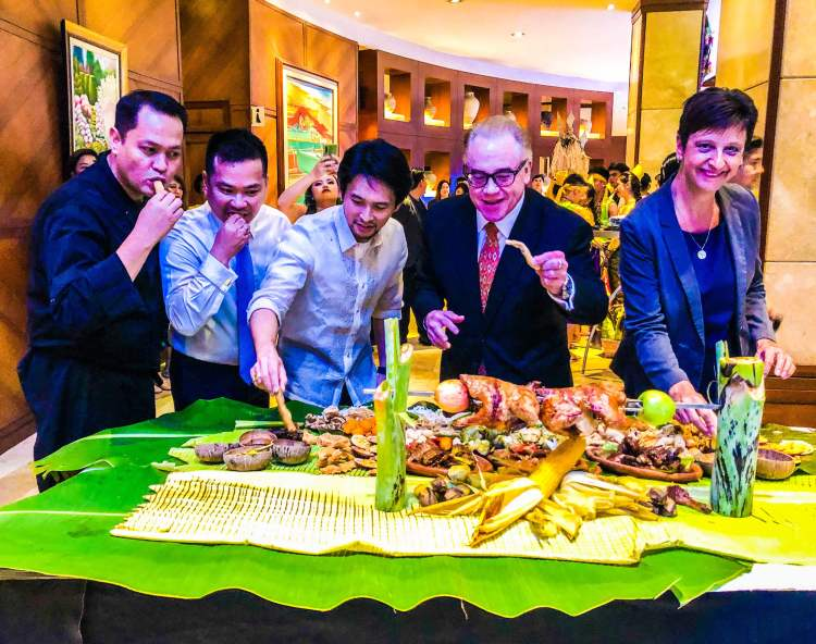 OPENING FEAST. (From left) Marco Polo Plaza Cebu Executive Chef Juanito Abangan; Restaurants, Beverage & Events Director Joward Tongco; Sugbo Mercado Communications Director Michael Karlo Lim; General Manager Brian Connelly; and Resident Manager Michaela Priesner open Sugbusog with a traditional feast of Cebuano dishes.
