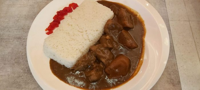 PORK CURRY. Japanese-style curry with slow-braised, tender pork and carrots served with Japanese white rice.