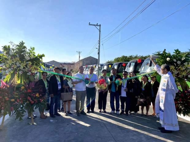 NEW UNITS. Cutting the ribbon during the blessing and launch of new PeoplesJeep units are LTFRB 7 Director Eduardo Montealto Jr (5th from left), Cebu People's Multi-Purpose Cooperative CEO Macario Quevedo (6th from left), CDA 7 Director Nora Patron (7th from left), Cebu People's Multi-Purpose Cooperative Board Chairperson Manolito S. Ardimer (8th from left), together with CPMPC board directors.