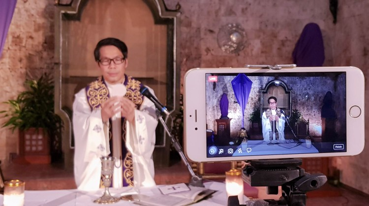 FACEBOOK LIVE. Fr. Joselito Danao of the Archdiocesan Shrine of the Immaculate Heart of Mary in Minglanilla, Cebu holds a mass and streams it via Facebook Live. Fr. Danao said livesteaming introduces a new avenue in encountering God using digital tools.