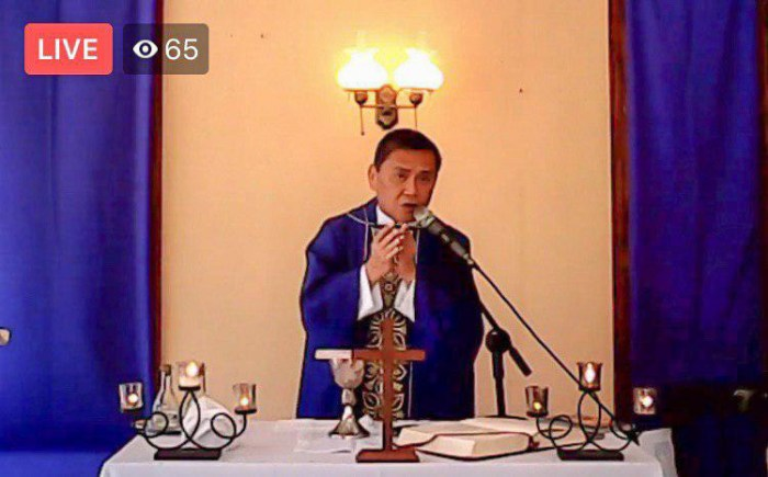 "VIRTUAL MASS. Msgr. Julius Perpetuo S. Heruela, parish priest of the St. Augustine of Hippo Parish in Bacong, Negros Oriental and a member of the Diocesan COVID Task Force, broadcasts a mass through Facebook Live. Msgr. Heruela said there are already 9 parishes in the Diocese of Dumaguete celebrating ""virtual masses."""